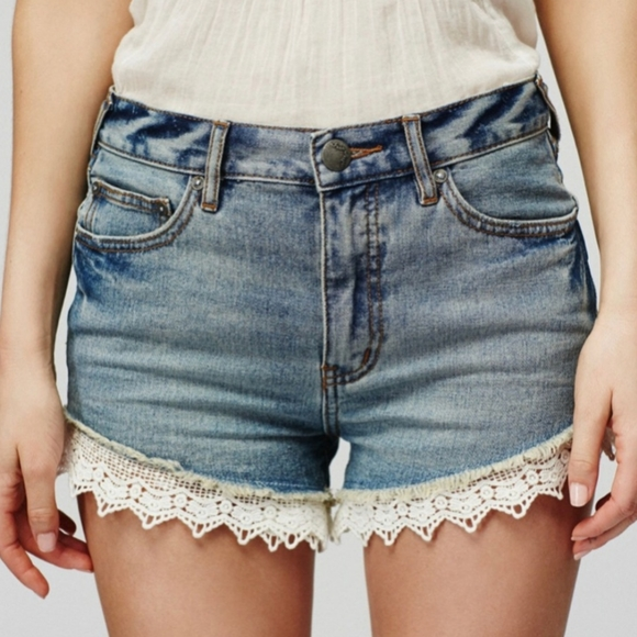 Free people jean shorts with lace detail t…